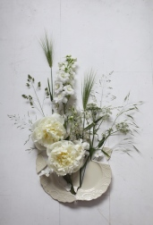 white floral installation with broken plate