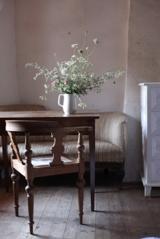 antique italian interiors with wild flower bouquet
