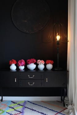 moody interiors, black wall and colorful rug via anastasiabenko.com