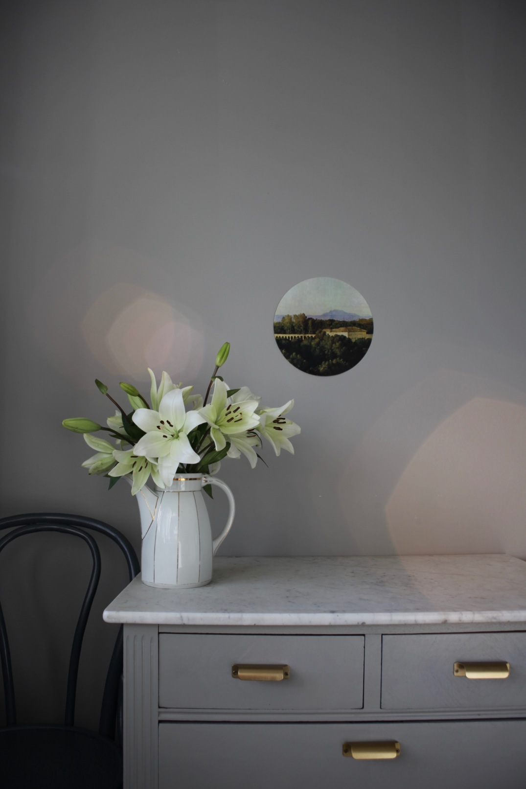 white lilies, grey kitchen details with sun bokeh via anastasiabenko.comkitchen details in the sun via Anastasia Benko