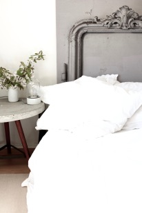 white bedroom with antique head board / DIY concrete table / stylist Anastasia Benko