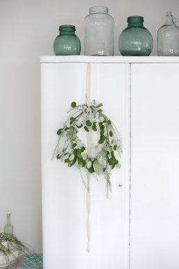 white bedroom with wreath