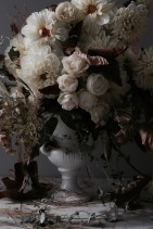 moody dahlia arrangement with white roses