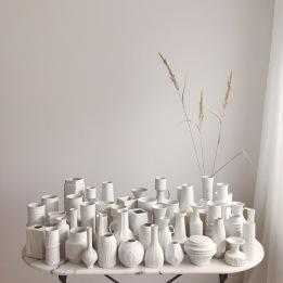white vintage vases on marble table