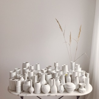 white vintage vases on marble table
