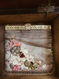 Antique purse with silk and flowers