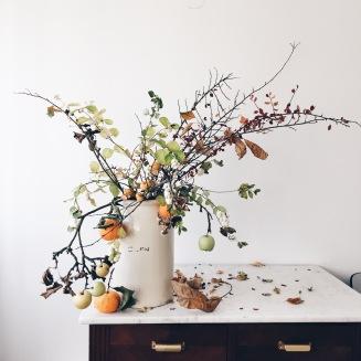 flower arrangement with branches and oranges via anastasiabenko.com