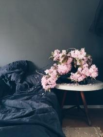 moody interiors with cherry blossoms via anastasiabenko.com