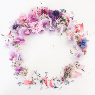 colorful summer flower wreath made with cornflower, cornflowers, sweetpea