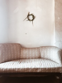 antique sofa with green wreath