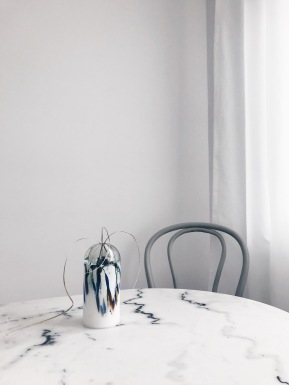Marble table with Murano vase