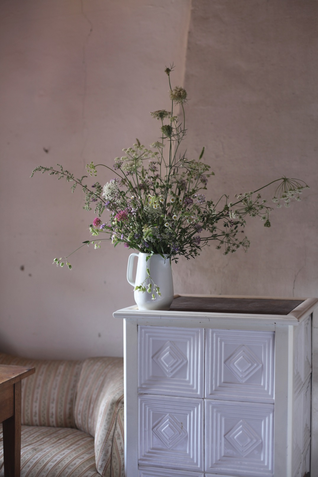 wild flower arrangement and old oven with white tiles