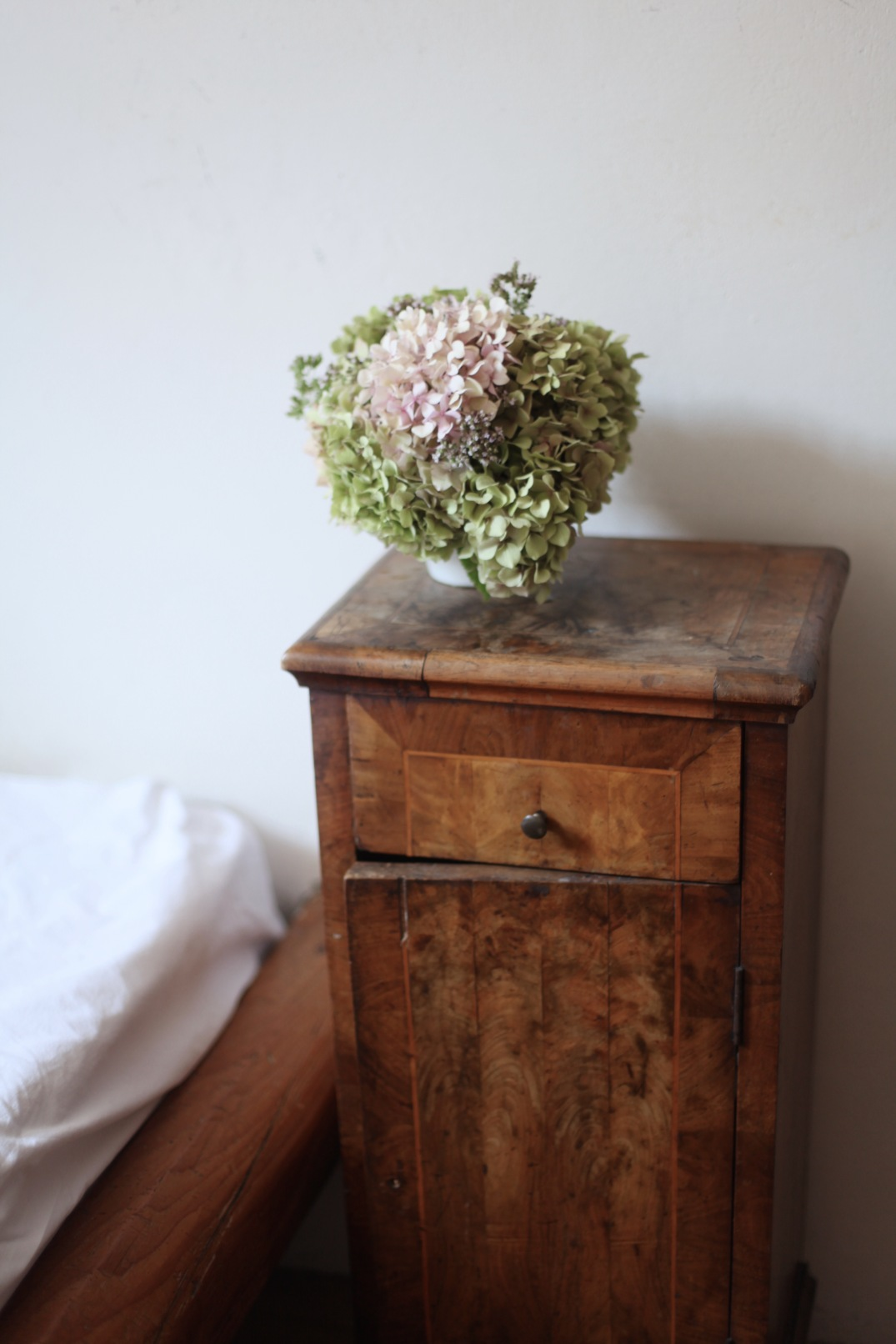 hydrangeas and an antique bedside table