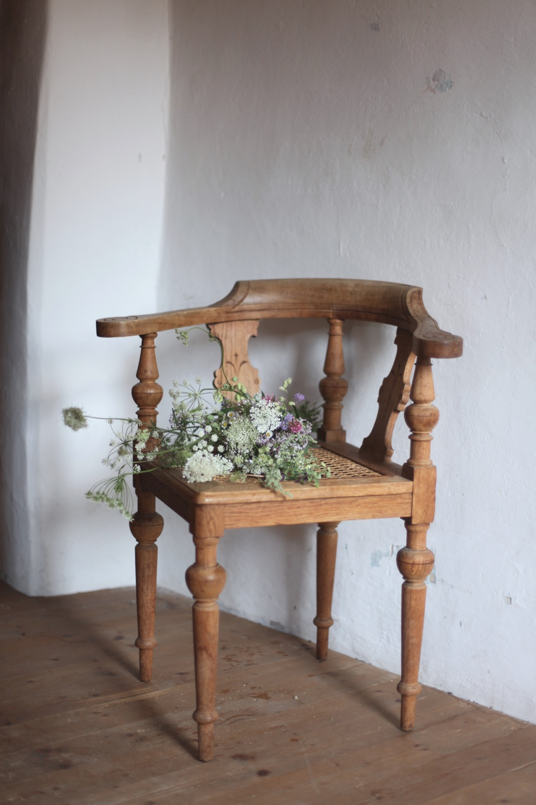 old chair and wild flower arrangement