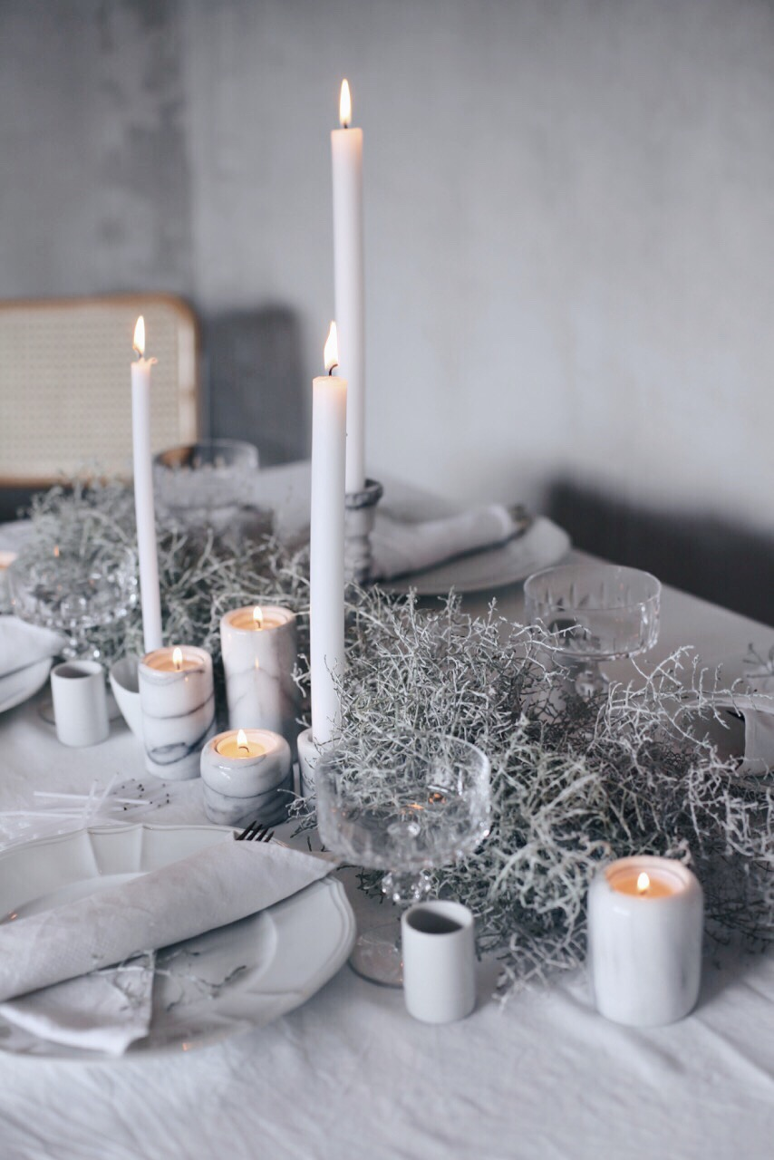 Winter table centerpiece with marble candleholders via Anastasia Benko