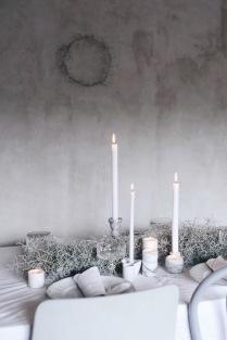 Winter table centerpiece with marble candleholders via Anastasia Benko