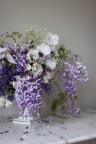 spring flower arrangement with wisteria, iris and roses / stylist Anastasia Benko