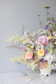 pastel summer flower arrangement with white hydrangea, roses, Queen Anne's lace, foxgloves, heuchera // stylist Anastasia Benko