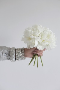 white peonies, floral arrangement, diamond bracelets
