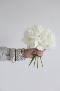 white peonies, floral arrangement, diamond bracelets