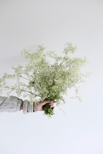 wild bedstraw flower arrangement, perfect wedding inspiration, diamond bracelets, nude nail polish