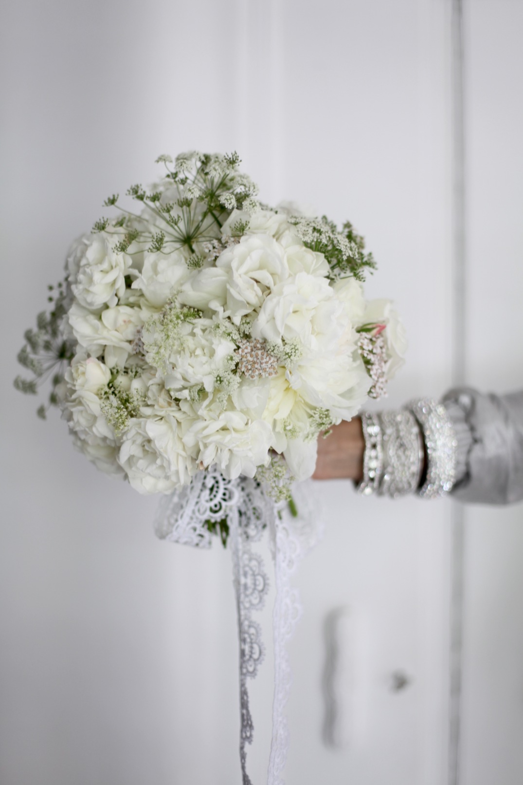White summer flower arrangement with peonies and roses