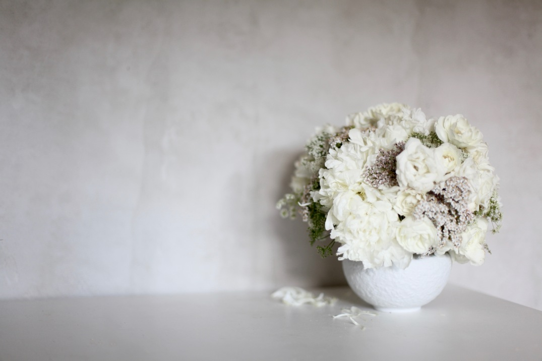 white floral arrangement, concrete walls