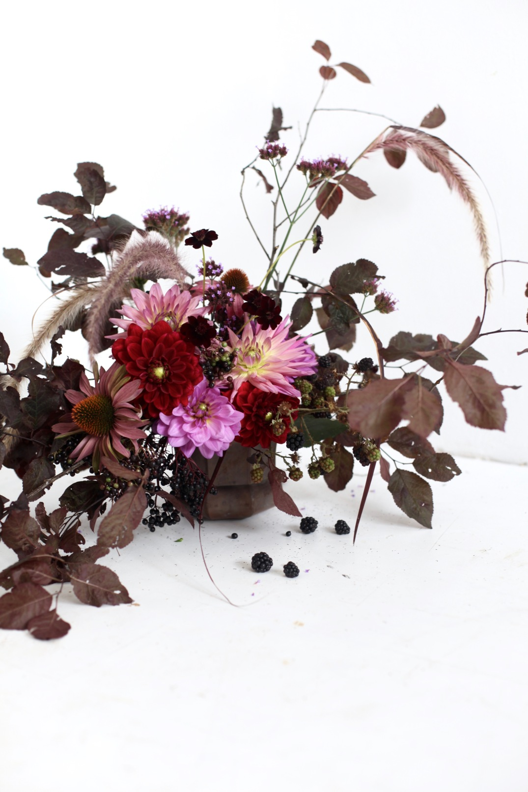 dahlia arrangement with black berries