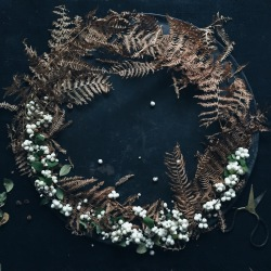 moody wreath with snowberries and dried fern