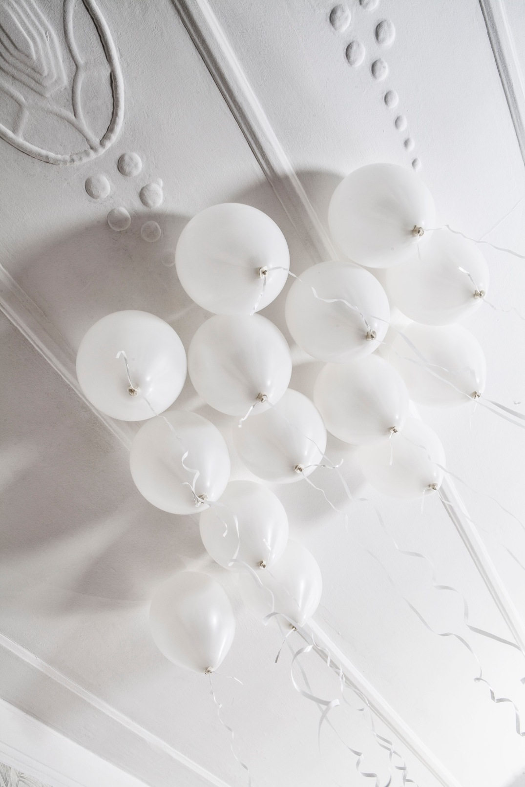 white balloons and art deco ceiling