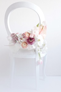 antique white chair with pink flowers