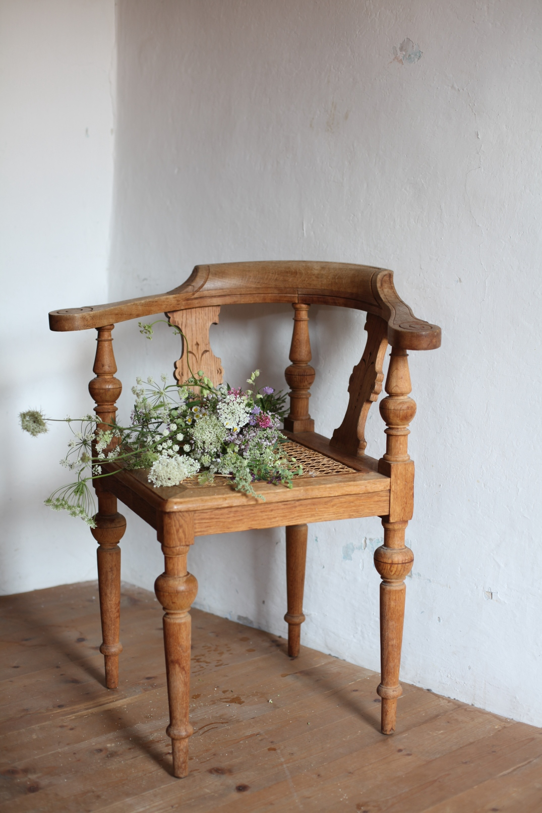 vintage chair with wild summer flowers