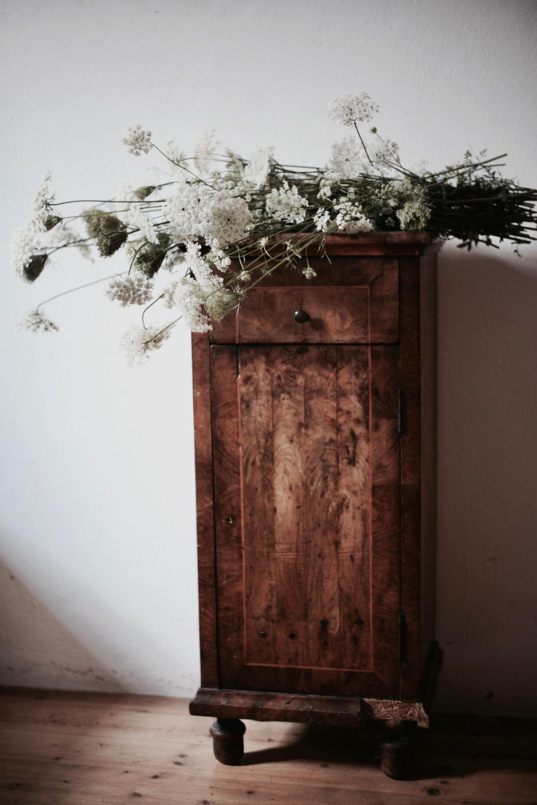 antique cabinet with wild summer flowers