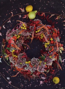colorful fall wreath with red berries and sedum