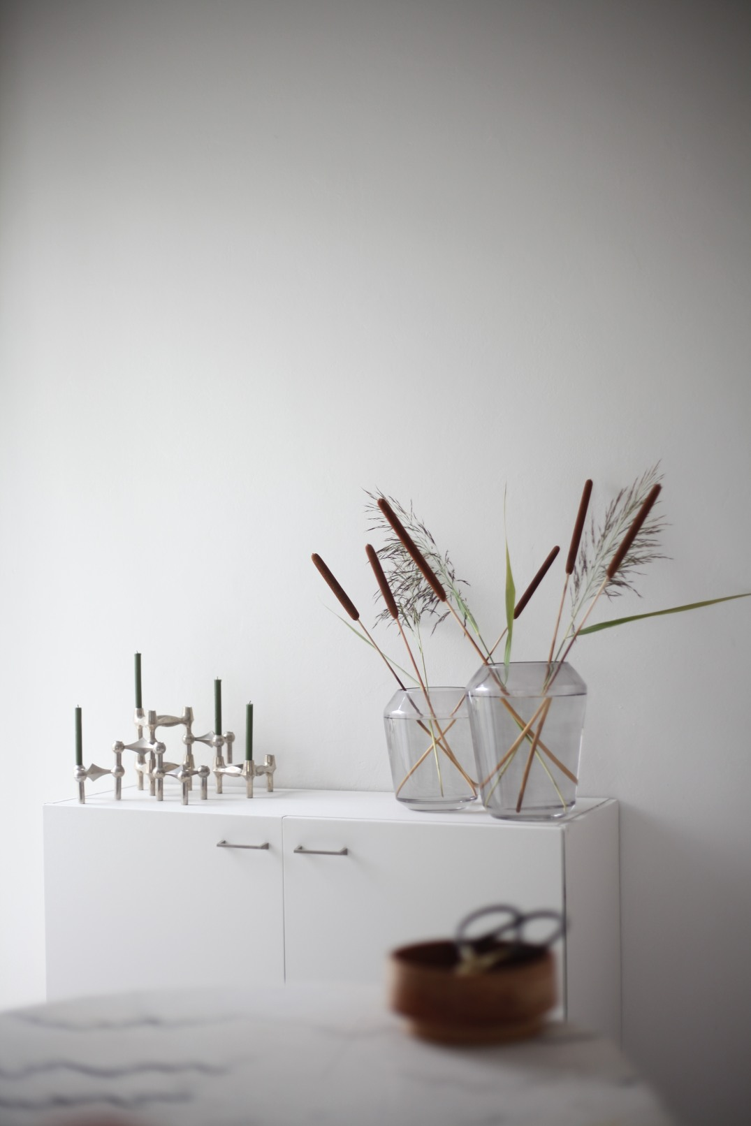 minimalistic late summer flower arrangement with reed