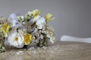 yellow and purple iris. roses and chestnut arrangement