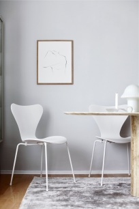 The Poster Club fine art ,Josephine' by Anastasia Benko, marble table, Peill & Puzler lamp, Fritz Hansen Series 7 Monochrome White, Arne Jacobsen chair